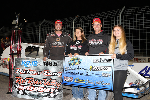 Austin Arneson in victory lane with the Todd Sanders family of Sanders Metal Products